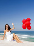 Girl with red ballons Stock Photos