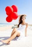 Girl with red ballons Royalty Free Stock Image
