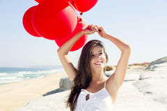 Girl with red ballons Royalty Free Stock Photography