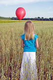 Girl with red balloon Royalty Free Stock Image