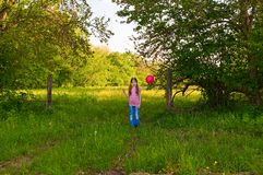 Girl with a red balloon Stock Photo