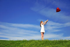 Girl with a red balloon in the form of heart Royalty Free Stock Photography