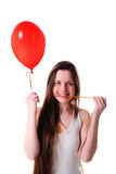 Girl with red balloon heart Stock Photography