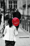 A girl with red balloon isolated b&w Stock Photos
