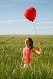 Girl with the red balloon Stock Image