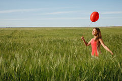 Girl with the red balloon Stock Images