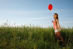 Girl with the red balloon Stock Photos