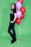 The girl with red balloons Stock Image