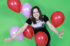 The girl with red balloons Stock Images