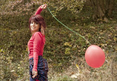 Girl and red baloon Royalty Free Stock Image