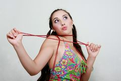 Girl with red beads Stock Photography
