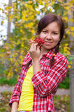 Girl with red berries Stock Images