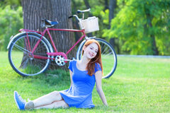 Girl with red bicycle Royalty Free Stock Photos