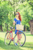 Girl with red bicycle Stock Image