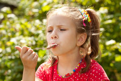 Girl in a red blouse eating ice cream Royalty Free Stock Photos