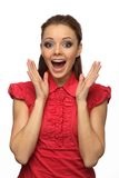 Girl in red blouse happily surprised Royalty Free Stock Images