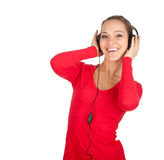 Girl in red blouse with headphones Stock Image