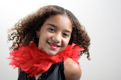 Girl in red boa smiling Royalty Free Stock Images