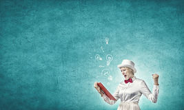 Girl with red book Royalty Free Stock Images