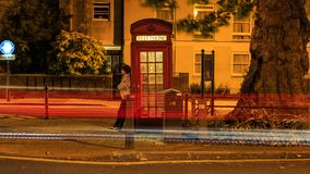 The girl at the red booth. In London Royalty Free Stock Images