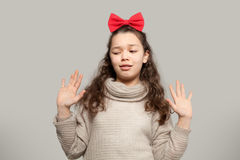 Girl with red bow Royalty Free Stock Photo