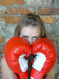 Girl in red boxing gloves. Young beautiful girl in red boxing gloves Royalty Free Stock Photo