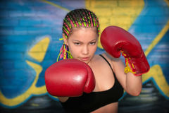 Girl with red boxing gloves Royalty Free Stock Image