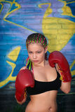 Girl with red boxing gloves Stock Images