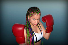 Girl with red boxing gloves Stock Photos