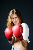 Girl with red boxing gloves Royalty Free Stock Photo