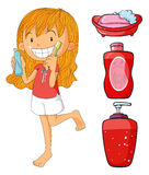 Girl in red brushing teeth Royalty Free Stock Photos