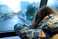 The girl in the red bus in London Stock Photography