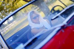 Girl and red cabriolet Royalty Free Stock Photos