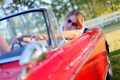 Girl and red cabriolet Royalty Free Stock Photography