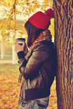 Girl in red cap drinking coffee Royalty Free Stock Images