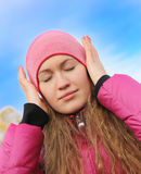 Girl in red cap with headache Royalty Free Stock Photo