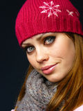 Girl in a red cap and a knitted scarf. Very beautiful young girl in a red cap and a knitted scarf Stock Image