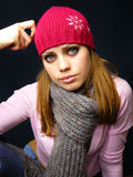 Girl in a red cap and a knitted scarf. Beautiful girl in a red cap and a knitted scarf Stock Images