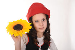 Girl in a red cap with a sunflower Royalty Free Stock Photo