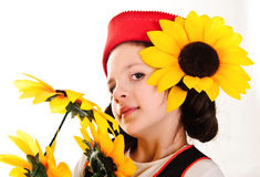 Girl in a red cap with a sunflower Stock Image