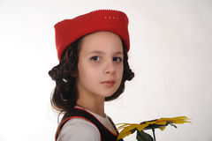 Girl in a red cap with a sunflower Royalty Free Stock Photos