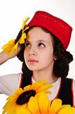 Girl in a red cap with a sunflower Royalty Free Stock Photography