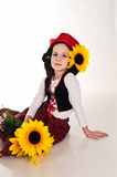 Girl in a red cap with a sunflower Stock Photography
