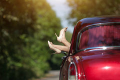 Girl in red car Royalty Free Stock Images
