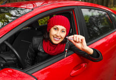 Girl in the red car. Stock Photos