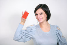 Girl with a red card Stock Image