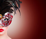 Girl in red carnival mask Stock Photography