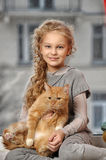 Girl with a red cat Royalty Free Stock Photography