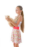 The girl with a red cat. Of breed Scottish-straight are photographed on the white background Royalty Free Stock Photography