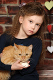 Girl with a red cat Stock Photo